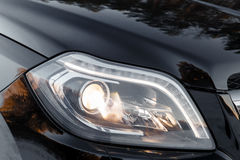 Headlights of black car Royalty Free Stock Photos