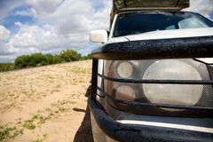 Headlights and bumper of a 4x4 car - Kalahari Royalty Free Stock Photos