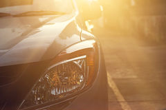Headlights of car at light sunset on the street background Stock Image