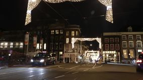 Headlights car passing down street at night. Time Lapse. AMSTERDAM, NETHERLANDS - JANUARY 03, 2017: Headlights car passing down street at night. Time Lapse stock video