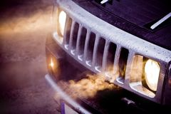 Headlights and chrome grille of a big powerful American SUV Royalty Free Stock Images