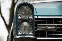 Headlights of a classic American car under rain on Queen Ann hil Stock Photo