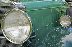 Headlights of a classic car Stock Images