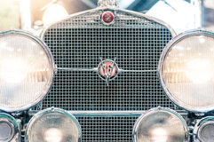 Headlights and grille of a vintage cadillac. Stock Image