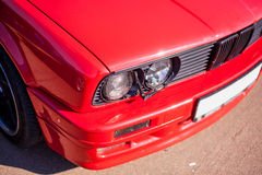 Headlights with headlight washer of the old red car Stock Image
