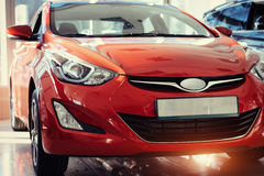 Headlights and hood of sport red car. Stock Images