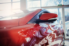 Headlights and hood of sport red car. Royalty Free Stock Photo