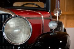 Headlights and mirrors of an antique car. Headlights and mirrors of a red antique car Royalty Free Stock Photo