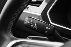 Headlights mode selector, modern car. Interior details Stock Photo