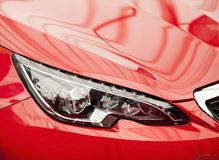 Headlights- new sports car detail Royalty Free Stock Image