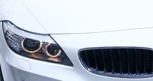 Headlights of new white car Stock Image