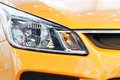 Headlights of orange car Stock Photography