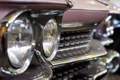 The headlights of the pink retro car. Glass headlights of the pink retro car photographed by macro photography Royalty Free Stock Images