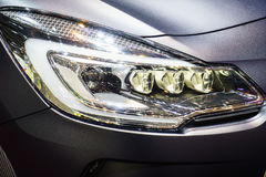 Headlights. Of a sport car, Motor Show Geneve 2015. Photo taken on: March 5th, 2015 royalty free stock images