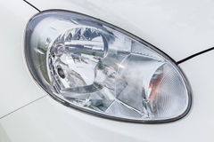 Headlights of a white car Stock Image