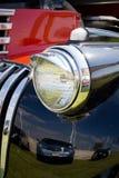 Headligth en coche negro viejo Foto de archivo libre de regalías