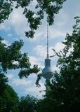 HeadlineBerliner Fernsehturm or TV Tower, Berlin, Germany. Berliner Fernsehturm or TV Tower seen through the leaves of some trees Royalty Free Stock Images