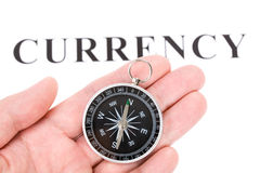Headline currency and Compass Stock Image