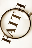 Headline faith and magnifier Stock Images