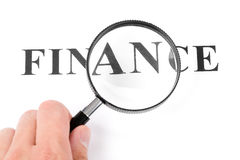 Headline finance and magnifier Stock Images