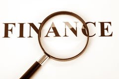 Headline finance and magnifier Royalty Free Stock Photo