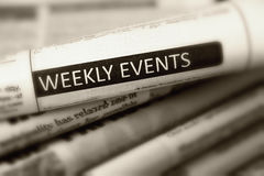 Headline Weekly events of one of newspaper. In the pile of newspapers. Black and white Royalty Free Stock Photos