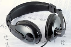 Headphone. A headphone on blank staffs Stock Photo