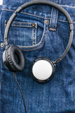 Headphone on blue jean background Royalty Free Stock Images