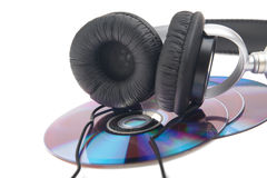 Headphone and compact discs. On a white background Stock Image