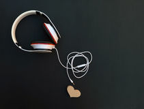 Headphone connector is disconnected from the heart. Concept. Royalty Free Stock Photography