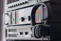 Headphone on control audio panel Stock Image