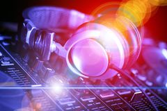 Headphone and DJ control gear, electronic night party. Controller and headphone DJ equipment, electronic night party, electronic advertising party, poster royalty free stock photography