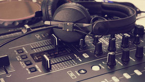 Headphone on dj mix console and music mixer Stock Photography