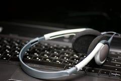 Earphone keyboard black Stock Photography