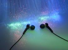 Headphone with fiber optical background Stock Photos