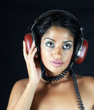 Headphone girl Stock Images