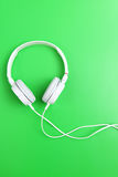 Headphone on green background Stock Photography