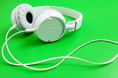 Headphone on green background Royalty Free Stock Photography