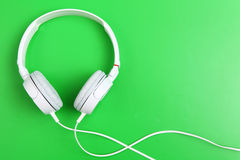 Headphone on green background Royalty Free Stock Photo