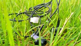 Headphone in green field Stock Photos