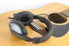 Headphone on guitar Royalty Free Stock Photo