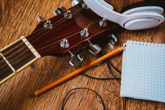 Headphone guitar notebook and pencil Stock Photography