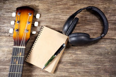 Headphone guitar notebook pencil Royalty Free Stock Images