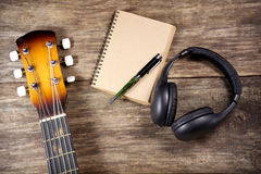 Headphone guitar notebook pencil Royalty Free Stock Photography