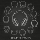 Headphone linear white Silhouettes Set on the chalkboard background Royalty Free Stock Image