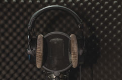 Headphone  microphone recording studio on a black background. Royalty Free Stock Image