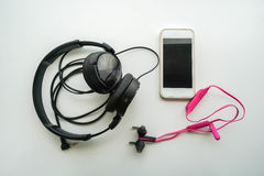 Headphone and mobile phone with wireless earphone Stock Photography