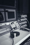 Headphone on Music mixer control desk in studio Royalty Free Stock Photography