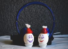 Headphone music to make eggs happy stock photos