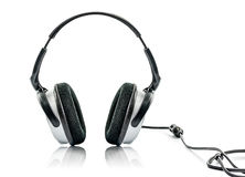 Headphone och volym royaltyfri foto